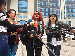"""May 30, 2017 - Istanbul, Turkey - A lawyer says a Turkish court has acquitted two Turkish men who were charged with aiding and abetting their younger brother in the 2005 shooting death of their sister in Germany. Hatun Surucu, a 23-year-old divorced mother, was slain in Berlin by her youngest brother in what prosecutors described as an ''honor killing'' meant to punish her for her Western lifestyle. The 20-year-old shooter was sentenced to 9 years and 3 months in prison in April 2006. Surucu's two older brothers _ Alpaslan and Mutlu Surucu _ were acquitted in Germany and left for Turkey.  A German court later annulled the acquittals and Turkey agreed to prosecute them. Women's rights lawyer Leyla Suren (C) said an Istanbul court acquitted them on Monday after concluded that the slaying was not a """"family decision."""" in Istanbul, Turkey, on May 30. (Credit Image: © Yuksel Koc/Depo Photos via ZUMA Wire)"""