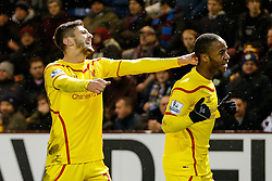 Raheem Sterling of Liverpool celebrates with Adam Lallana after scoring a goal to make it 0-1 - Photo mandatory by-line: Rogan Thomson/JMP - 07966 386802 - 26/12/2014 - SPORT - FOOTBALL - Burnley, England - Turf Moor Stadium - Burnley v Liverpool - Boxing Day Christmas Football - Barclays Premier League.
