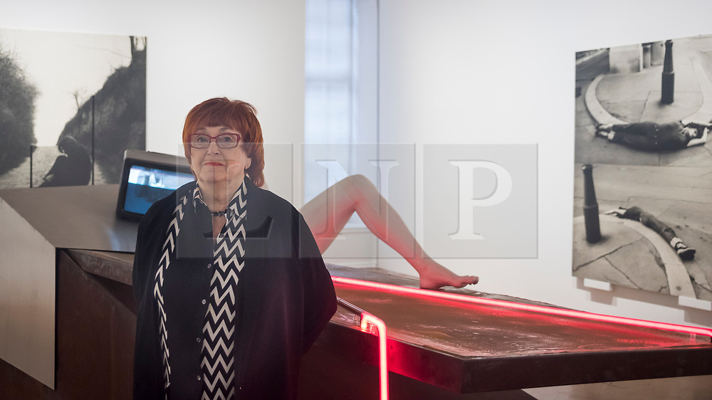 """© Licensed to London News Pictures. 28/11/2019. LONDON, UK.  Preview of """"The 1980 Venice Biennale Works"""" by Austrian artist Valie Export (pictured) at Galerie Thaddeus Ropac in Mayfair.  The exhibition comprises innovative multimedia installation from the 39th Venice Biennale and 17 large-scale photographs mounted on wooden panels from her important photographic series Body Configurations (1972–82).  The show runs 28 November to 25 January 2020.  Photo credit: Stephen Chung/LNP"""