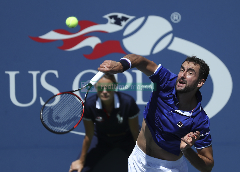 NEW YORK, Sept. 2, 2017  Marin Cilic of Croatia serves during the men's singles third round match against Diego Schwartzman of Argentina at the 2017 US Open in New York, the United States, Sept. 1, 2017. Diego Schwartzman won 3-1. (Credit Image: © Wang Ying/Xinhua via ZUMA Wire)