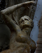 Detail of the bust of a female sculpture, Fontana Diana, Giulio Moschetti, 1906, on Piazza Archimede in Ortigia, Syracuse, Sicily, pictured on September 13, 2009, in the morning. The Diana Fountain is the centre of the Piazza Archimede in Ortigia, the historic centre of Syracuse. It tells the mythological story of Diana transforming the nymph Arethusa into a spring on a site in Ortigia. Ortigia is one of the names associated with the goddess Artemis, the Romans identified her as Diana. The Piazza is named after the ingenious greek mathematician and philosopher Archimede who died defending Syracuse against the Romans. Today the city is a UNESCO World Heritage Site. Picture by Manuel Cohen.