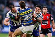 Lachlan Burr and Issac Luke make a tackle on Ethan Parry. Parramatta Eels v Vodafone Warriors. NRL Rugby League. Bankwest Stadium, Sydney, Australia. 27th July 2019. Copyright Photo: David Neilson / www.photosport.nz