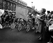 Actress Siobhan McKenna about to drop the flag to start the Rás Tailteann. The cycle race, which covers 900 miles around Ireland, would finish in Limerick on 12 June. A field of seventy-seven riders were listed to take part.<br />