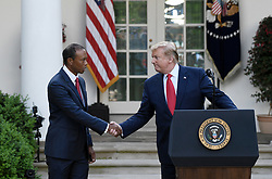 U.S. President Donald Trump shake hands with golf legend Tiger Woods during the Presidential Medal of Freedom ceremony in the Rose Garden at the White House, May 6, 2019 in Washington, DC. Photo by Olivier Douliery/ABACAPRESS.COM