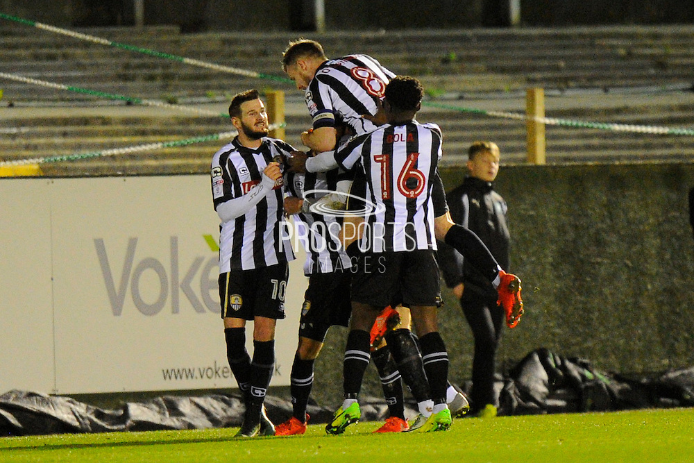 Jorge Grant (17) of Notts County is mobbed by his team mates while celebrating scoring a goal to give a 0-1 lead to the away team with Mark Yeates (10) of Notts County during the EFL Sky Bet League 2 match between Plymouth Argyle and Notts County at Home Park, Plymouth, England on 28 February 2017. Photo by Graham Hunt.