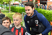 Adam Smith (15) of AFC Bournemouth has a selfie with a young fan on arrival before the Premier League match between Bournemouth and Tottenham Hotspur at the Vitality Stadium, Bournemouth, England on 4 May 2019.