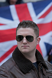 © Licensed to London News Pictures . 23/01/14 Former English Defence League leader Stephen Lennon, who uses the alias Tommy Robinson, has been jailed for 18 months today 23 January 2014 for mortgage fraud. FILE PICTURE DATED 17/04/2012. London, U.K. Tommy Robinson, The EDL leader.The English Defence League (EDL) hold a demonstration outside The Houses Of Parliament and the Home Office to protest at alleged 'government inaction' and 'lack of political will' to deport radicals like Abu Qatada. Anti- Fascist protesters also held a counter protest on the other side of the entrance to the Home Office building..Photo credit : Rich Bowen/LNP