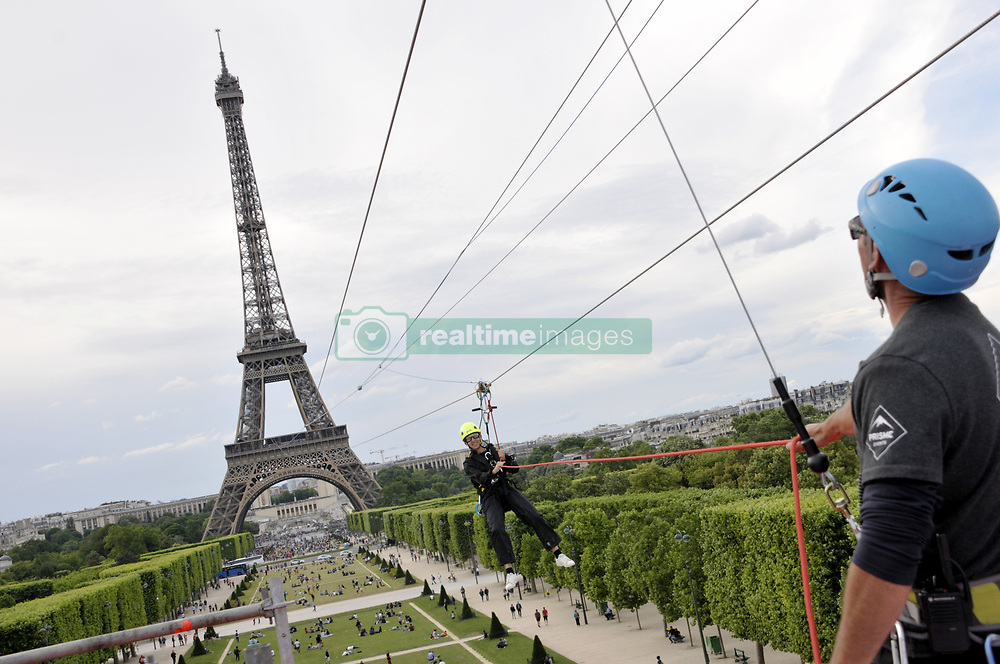 Perrier launches a Zip-line from the second floor of the Eiffel Tower to L'Ecole Militaire to Celebrate Roland Garros in Paris, France on June 5, 2017. Photo by Alain Apaydin/ABACAPRESS.COM