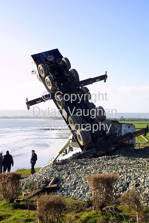17/1/2002 Irish Sun.The scene yesterday on the coast  road in Ballyvoile county Waterford where the crane tipped over..Picture Dylan Vaughan