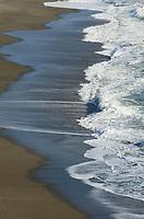 Waves crashing on sand beach, Sonoma Coast California