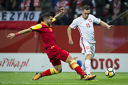 October 8, 2017 - Warsaw, Poland - Emrah Klimenta of Montenegro and Maciej Rybus of Poland during the FIFA World Cup 2018 Qualifying Round Group E match between Poland and Montenegro at National Stadium in Warsaw, Poland on October 8, 2017  (Credit Image: © Andrew Surma/NurPhoto via ZUMA Press)