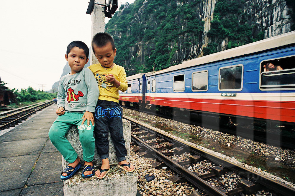 Kids at Le Son train station during autumn floods in central Vietnam, Quang Binh, Vietnam, Southeast Asia, 2016