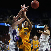 Breanna Stewart, UConn, (left), blocks DeVaughn Gray, East Carolina, during the UConn Huskies Vs East Carolina Pirates Quarter Final match at the  2016 American Athletic Conference Championships. Mohegan Sun Arena, Uncasville, Connecticut, USA. 5th March 2016. Photo Tim Clayton