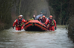 © London News Pictures. 11/02/2014. Wraysbury, UK.  Joy Levinson (corr) being rescued from her property by fire fighters in Wraysbury, Berkshire. The area has been hit hard by recent flooding from the nearby Thames River. Photo credit : Ben Cawthra/LNP