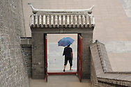 A lady leaves the Dongbianmen Gate in Beijing.