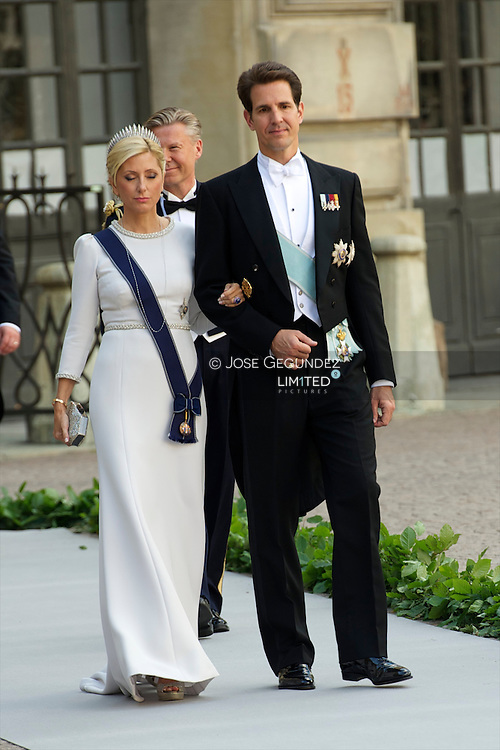 Crown Prince Pavlos of Greece and Crown Princess Marie-Chantal of Greece attend the wedding of Princess Madeleine of Sweden and Christopher O'Neill hosted by King Carl Gustaf XIV and Queen Silvia at The Royal Palace on June 8, 2013 in Stockholm, Sweden.
