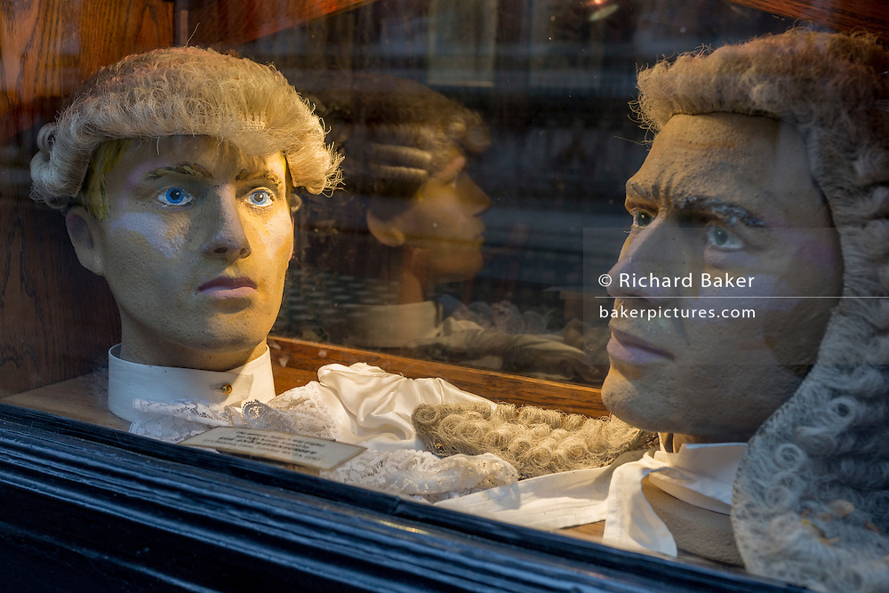 Court dress wigs for the legal profession (barristers and judges) donated by outfitters Ede & Ravenscroft, in the window of the Seven Stars pub opposite the Royal Courts of Justice, on 15th February 2017, in London, United Kingdom.