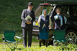 © London News Pictures. 12/05/2012. Windsor, UK. HRH Queen Elizabet II watching The Land Rover International Driving competition on day four of the Royal Windsor Horse Show in the grounds of Windsor Castle, Berkshire,  on May 12, 2012. Photo credit: Ben Cawthra/LNP