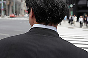 businessman at a pedestrian crossing