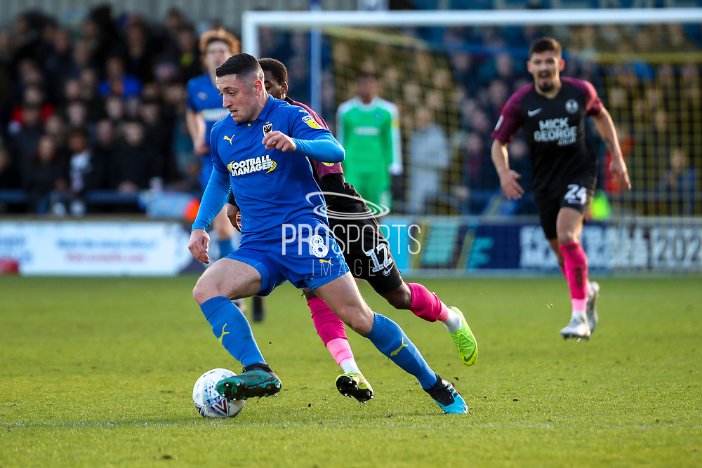 AFC Wimbledon midfielder Anthony Hartigan (8) battles for possession with Peterborough United midfielder Reece Brown (12) during the EFL Sky Bet League 1 match between AFC Wimbledon and Peterborough United at the Cherry Red Records Stadium, Kingston, England on 18 January 2020.