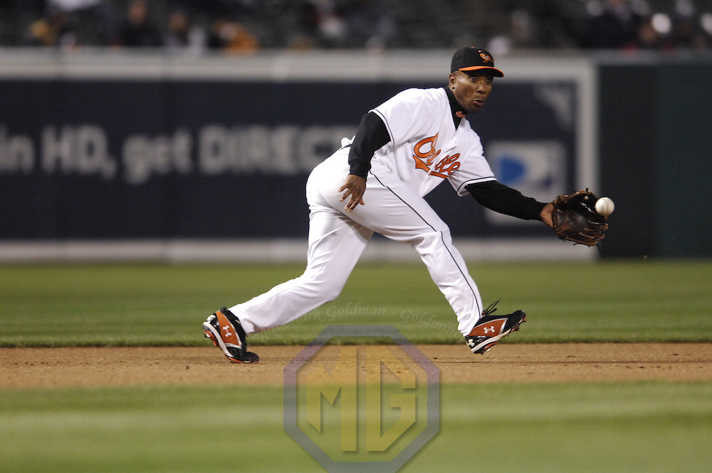 11 April 2007:   Baltimore Orioles third baseman Melvin Mora fields a ball hit by Detroit Tigers left fielder Craig Monroe in the 4th inning.  The Tigers defeated the Orioles 4-1 on  grand slam by left fielder Craig Monroe in the 12th inning at Camden Yards in Baltimore, MD.