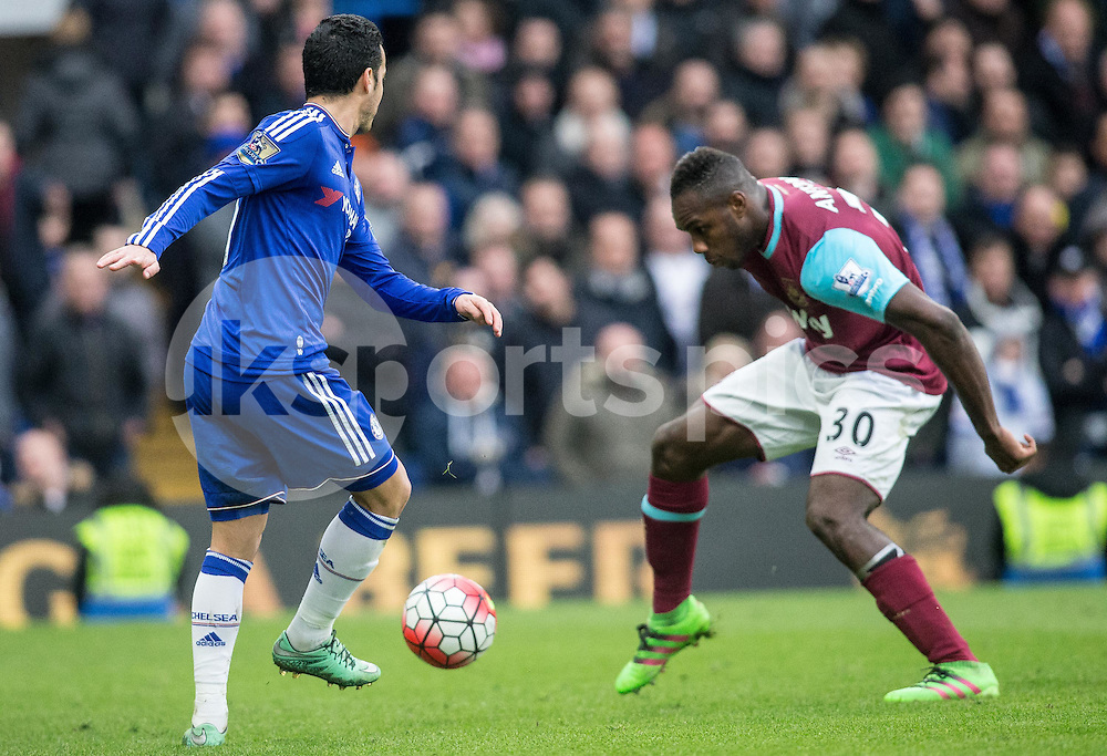 Pedro of Chelsea & Michail Antonio of West Ham United  during the Barclays Premier League match between Chelsea and West Ham United at Stamford Bridge, London, England on 19 March 2016. Photo by Steve Ball.