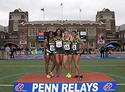 Apr 27, 2018; Philadelphia, PA, USA;  Members of the Bullis (Md.) girls 4 x 400m relay pose after placing third in the Championship of America in 3:41.51 as the top United States team during the 124th Penn Relays at Franklin Field. From left: Ayanna Johnosn, Sierra Leonard, Lauryn Harris and Masai Russell.
