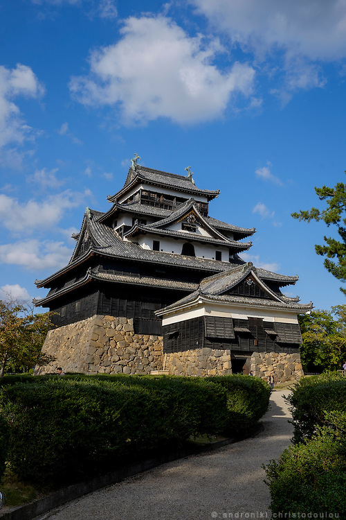 Matsue Castle (松江城 Matsue-jō) is a feudal castle in Matsue in Shimane prefecture, Japan. Nicknamed the &quot;black castle&quot; or &quot;plover castle&quot;, it is one of the few remaining medieval castles in Japan &ndash; at least of the few remaining in their original wooden form, and not a modern reconstruction in concrete.<br /> <br /> The construction of Matsue Castle began in 1607 and finished in 1611, under the local lord Horio Yoshiharu. In 1638, the fief and castle passed to the Matsudaira clan, a junior branch of the ruling Tokugawa clan.
