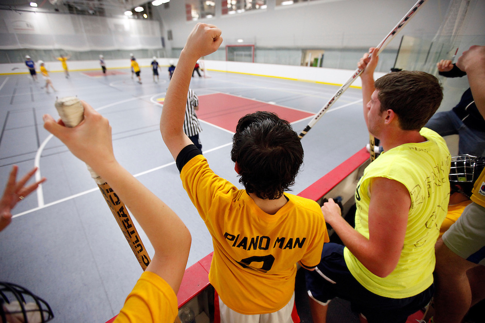 -November 4, 2009, Boston, MA-..The Vagiants were able to hold onto the lead against the Little Brown Filipino Warriors in the first round of the Co-Ed Floor Hockey Championships at the Boston University Fitness and Recreation Center on Wednesday night where Paul Squire, center, celebrates a goal.  The Vagiants won, 3-1, assuring a spot in the Championships on Sunday, when they hope to repeat their 2008 success...(Photo by Brooks Canaday)