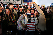 Supporters entertain themselves while waiting for Republican presidential candidate Gov. Chris Christie, R-N.J., to arrive at a town hall meeting at Millennium Running HQ in Bedford, New Hampshire Saturday, Feb. 6, 2016.  CREDIT: Cheryl Senter for The New York Times