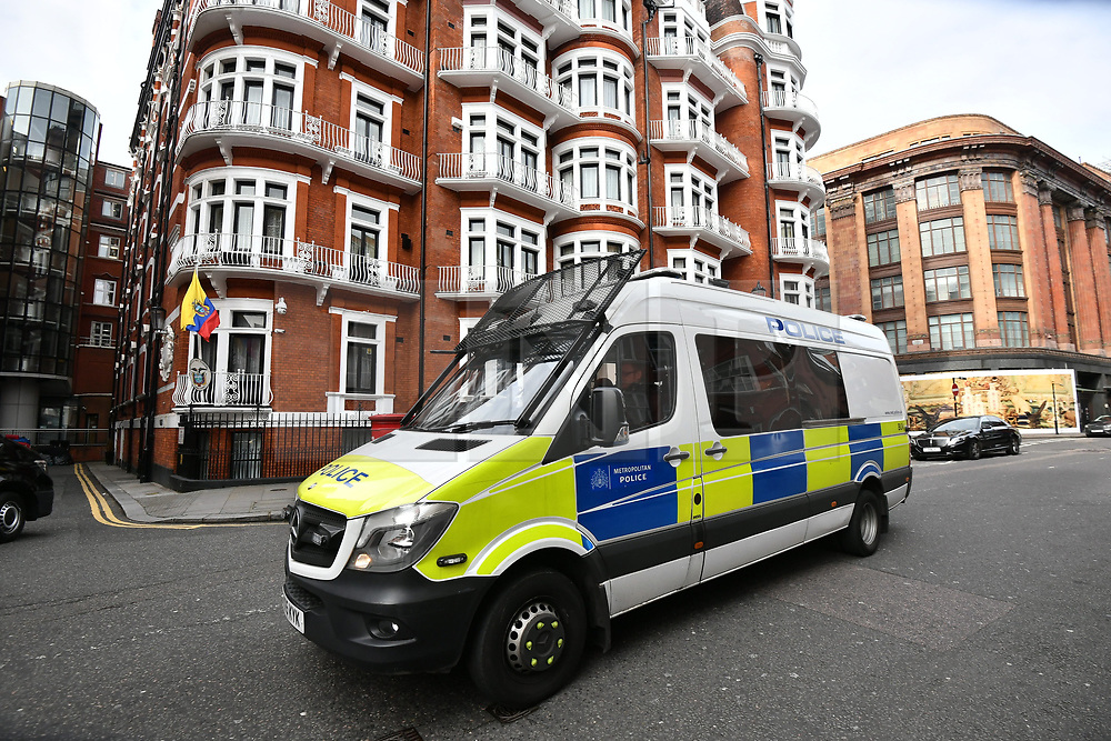 © Licensed to London News Pictures. 05/04/2019. London, UK. Police patrol at the scene outside the Ecuador Embassy in London where the Wikileaks founder Julian Assange has been living since 2012. It has be reported that Assange is due to be thrown out of the embassy. Swedish authorities recently dropped their investigation into rape allegations against Assange. Photo credit: Ben Cawthra/LNP