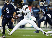 Jacksonville Jaguars rookie defensive back Ronnie Harrison (36) leaps for yards after a catch as he intercepts a first quarter pass and returns it 14 yards to the Jaguars 40 yard line during the week 14 regular season NFL football game against the Tennessee Titans on Thursday, Dec. 6, 2018 in Nashville, Tenn. The Titans won the game 30-9. (©Paul Anthony Spinelli)