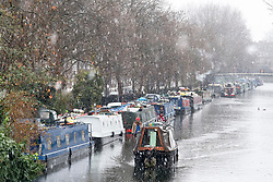 © Licensed to London News Pictures. 11/12/2017. London, UK. A canal boat makes it's way through heavy snowfall on the Grand Union Canal in Little Venice, Westminster, central London on December 11, 2017. Further snowfall has hit parts of the south east of England causing travel disruption. Photo credit: Ben Cawthra/LNP
