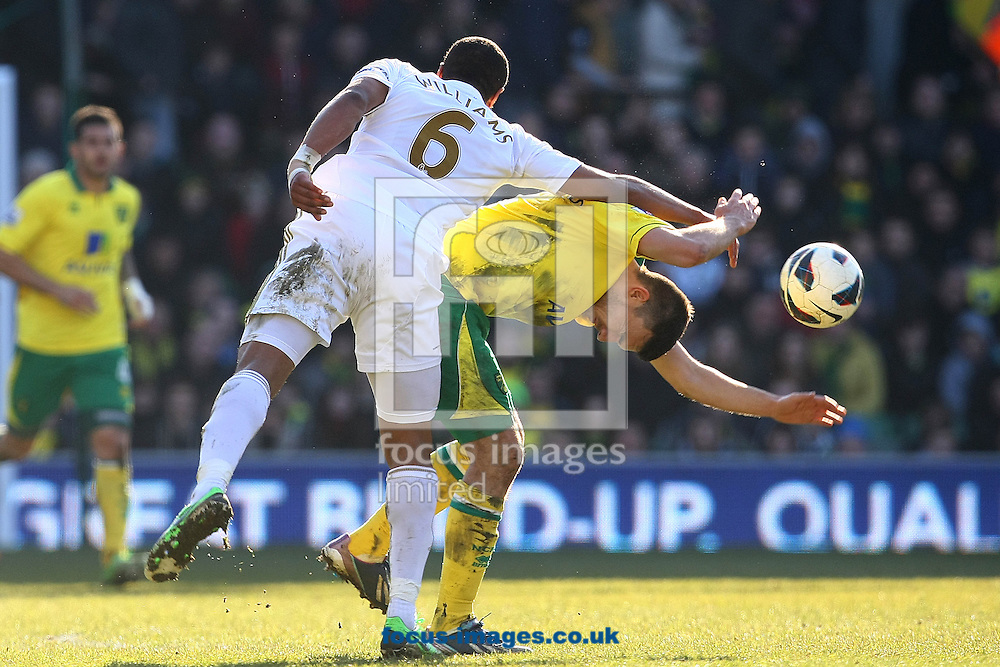 Picture by Paul Chesterton/Focus Images Ltd +44 7904 640267.06/04/2013.Ashley Williams of Swansea and Robert Snodgrass of Norwich in action during the Barclays Premier League match at Carrow Road, Norwich.