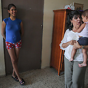 Judith Torres-Kilgore, who works with the Community Preparedness Office of Public Health Preparedness and Response at thePuerto Rico Department of Health visits with Kimberly Torres, 21, and her daughter, at Kimberly's apartment near Guayama, Puerto Rico. Kimberly is pregnant with her second child. Right now, Zika is spreading rapidly in Puerto Rico and pregnant women are at risk for becoming infected with Zika which can cause microcephaly and other birth defects. If the current trends continue, at least 1 in 4 people, including women who become pregnant, may become infected with Zika.
