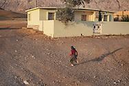 16/05/15. Awbar Village, Darbandikhan area, Iraq. -- A neighbour of Najm runs to gather the herd in the evening.