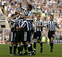 Photo. Glyn Thomas.<br /> Newcastle United v Chelsea. <br /> FA Barclaycard Premiership. 25/04/2004.<br /> Newcastle's Alan Shearer is mobbed by Hugo Viana (arm raised) and other teammates after his brilliant second half goal.