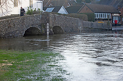 ©Licensed to London News Pictures 23/12/2019. <br /> Eynsford ,UK.High water level at Eynsford ford as an elderly man walks over the bridge. The River Darent water levels have continued to rise this morning causing flooding to parts of Eynsford Village in Kent. Photo credit: Grant Falvey/LNP