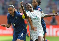 26.06.2011, Rhein-Neckar-Arena, Sinsheim, GER, FIFA Women's Worldcup 2011, GRUPPE A, NIGERIA (NGA) vs FRANKREICH (FRA) , im Bild Ophelie MEILLEROUX (FRA #5, Montpellier) im Zweikampf mit Perpetua NKWOCHA (NGA #4,Sunnana SWE)   // during the FIFA Women's Worldcup 2011, Pool A, Nigeria (NGA) vs France (FRA) on 2011/06/26, Rhein-Neckar-Arena, Sinsheim, Germany. EXPA Pictures © 2011, PhotoCredit: EXPA/ nph/  Roth       ****** out of GER / SWE / CRO  / BEL ******