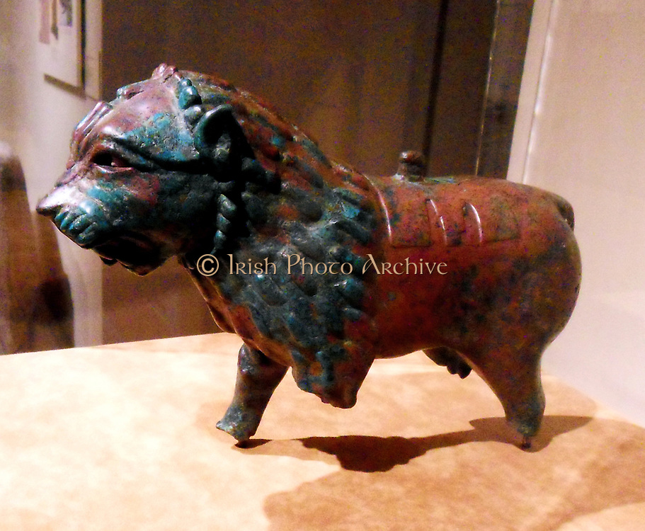 Anatolian or Syrian lion figure in copper alloy. Ist Millennium BC. Assyrian