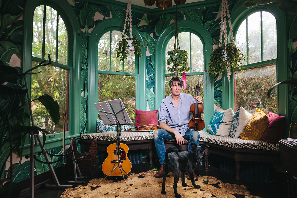 PORTLAND, OR - APRIL 27: Musician Stephen Malkmus at home with Magic, his family's new puppy. (Photo by Jason Quigley/For The Washington Post)