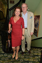 CHRISTOPHER & MARDI GILMOUR at a Bastille Day Cocktail Party at L'Escargot, 48 Greek Street, London on 14th July 2014.