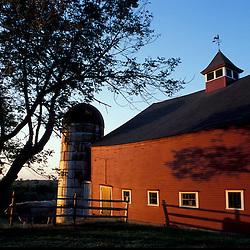 Bolton, MA.  USA.  A red barn on the Schartner Farm in Massachusetts' Nashoba Valley.  Apple orchard.