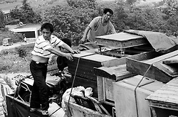 Villagers of Cangfang town load their belongings on trucks in preparations for relocation to neighbouring Hui county to make way for the colossal South-to-North Water Transfer project in Xichuan county of Henan Province in China on 28 June 2010. The South-to-North Water Transfer project, the largest known water diversion project, was conceived in 1952 to solve the country's chronic water shortages and involves creating three routes to channel 44.8 billion cu m of water from southern China to the northern areas. As part of the project's central route, affecting Henan and Hubei provinces, water from the Danjiangkou reservoir will be diverted to Beijing. The central route, which will raise the height of the Danjiangkou reservoir dam from 162 meters to 176.6 meters, requires the relocation of 330,000 people in Henan and Hubei provinces. Parts of Xichuan county, a remote, mountainous region inaccessible by railway and home to 162,000 migrants, the most anywhere, will be completely submerged by water from the Danjiangkou reservoir by 2014. The vast resettlement of affected residents in Xichuan county began in August 2009 and lasted till 2011.