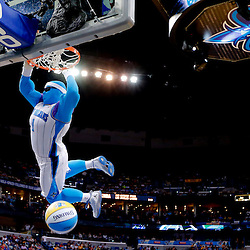 Apr 14, 2013; New Orleans, LA, USA; New Orleans Hornets mascot Super Hugo dunk during a timeout during the second quarter of a game against the Dallas Mavericks at the New Orleans Arena. Mandatory Credit: Derick E. Hingle-USA TODAY Sports