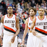 04 December 2013: Portland Trail Blazers power forward LaMarcus Aldridge (12), Portland Trail Blazers center Robin Lopez (42) and Portland Trail Blazers small forward Nicolas Batum (88) are seen during the Portland Trail Blazers 111-104 victory over the Oklahoma City Thunder at the Moda Center, Portland, Oregon, USA.