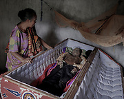 Deborah Cesan with her husband, Tandi Kadida, who passed away in 2012 at age 65. They were married for 47 years.<br /> <br /> Ma'nene is a tradition that takes place in August after harvest where the bodies of the dead loved ones are exhumed to be cleaned, groomed and dressed. For most, it's a bittersweet moment, a chance to reunite and physically see and touch and reconnect with loved ones who had passed on.