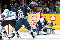 KELOWNA, CANADA - APRIL 23: Landon Bow #30 of Seattle Thunderbirds poke checks Cole Linaker #26 of Kelowna Rockets and makes a first period save on April 23, 2016 at Prospera Place in Kelowna, British Columbia, Canada.  (Photo by Marissa Baecker/Shoot the Breeze)  *** Local Caption *** Landon Bow; Cole Linaker;
