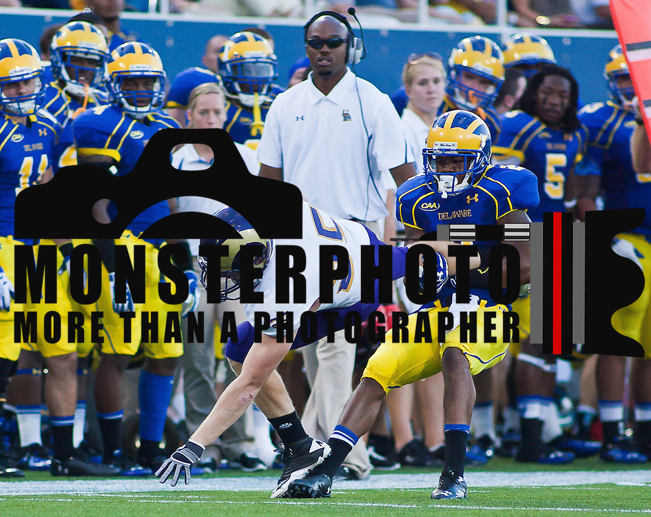 Delaware Cornerback Marcus Burley #2 tackles West Chester WR Tim Keyser #25 at the 30 yard line during a Week 2 NCAA football game against Westchester in the second quarter...#8 Delaware defeated Westchester 31-10  in their home opener at Delaware Stadium Saturday Sept. 10, 2011 in Newark DE...Delaware will return home Sept. 17, 2011 for a showdown with interstate Rival Delaware State at 6:pm at Delaware Stadium. (Monsterphoto/Saquan Stimpson)