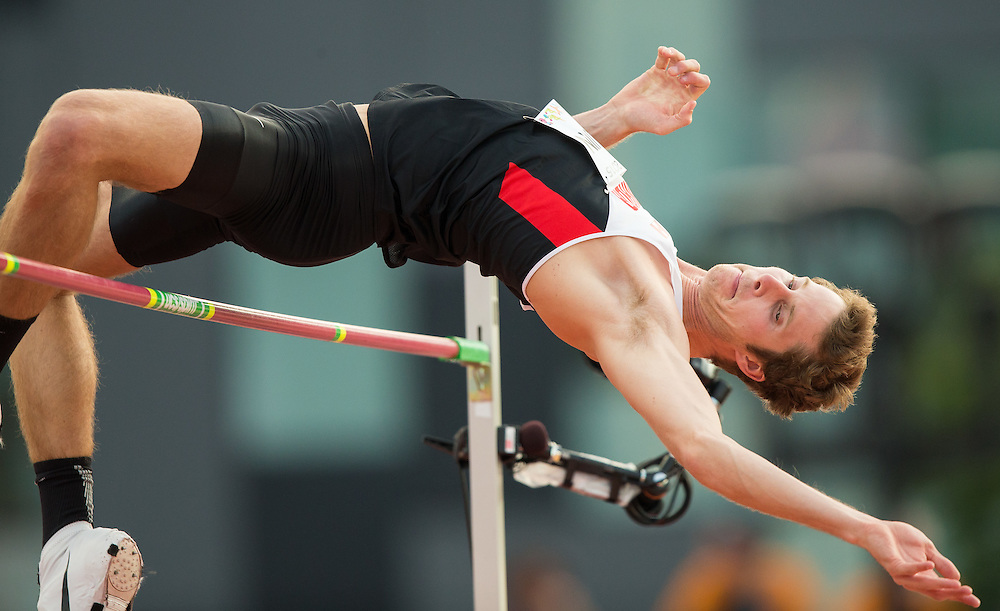 Derek Drouin of Canada competes in the men's high jump at the 2015 Pan American Games at CIBC Athletics Stadium in Toronto, Canada, July 25,  2015.  AFP PHOTO/GEOFF ROBINS